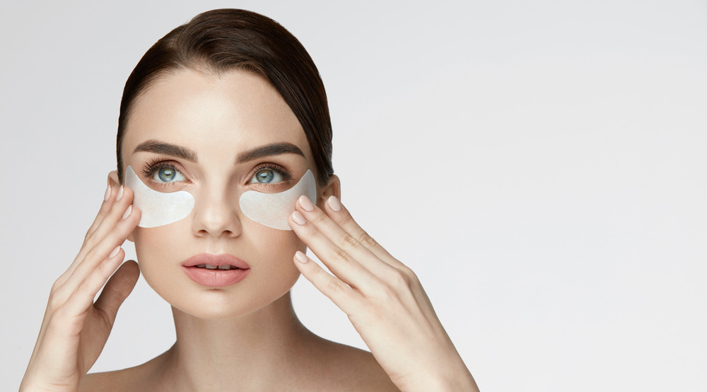 Woman with under-eye patches